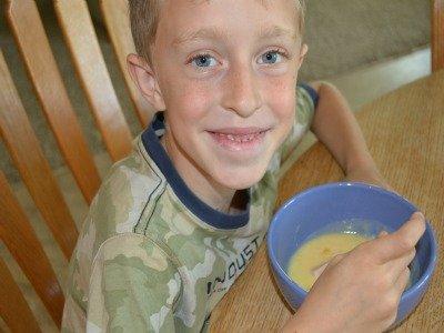 kid eating soup